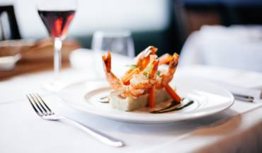 Roasted langoustines with artichoke chips and carcass sauce